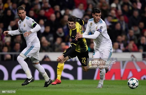 Dortmund's US midfielder Christian Pulisic vies with Real Madrid's Spanish defender Sergio Ramos and Real Madrid's French defender Theo Hernandez...