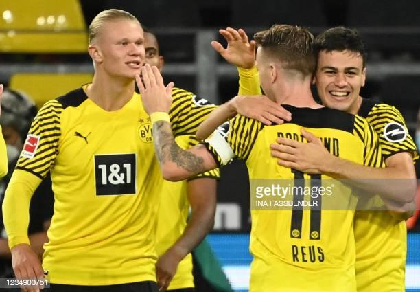 Dortmund's US midfielder Giovanni Reyna celebrates scoring the opening goal with his teammates Dortmund's German forward Marco Reus and Dortmund's...