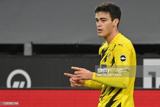 Dortmund's US midfielder Giovanni Reyna scores the 1-1 goal during the German first division Bundesliga football match BVB Borussia Dortmund v VfB...