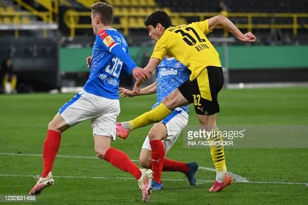 Dortmund's US midfielder Giovanni Reyna scores the opening goal during the German Cup semi-final football match BVB Borussia Dortmund v Holstein Kiel...