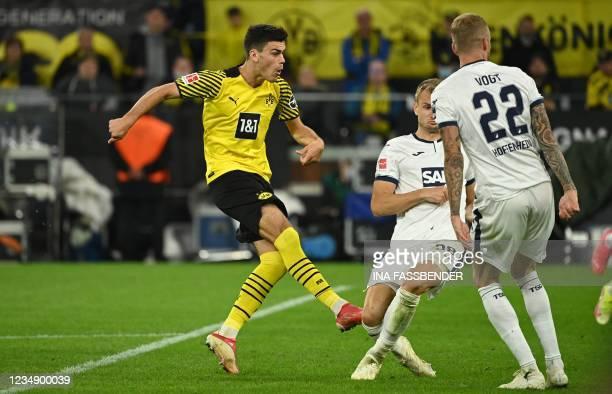 Dortmund's US midfielder Giovanni Reyna scores the opening goal during the German first division Bundesliga football match between Borussia Dortmund...