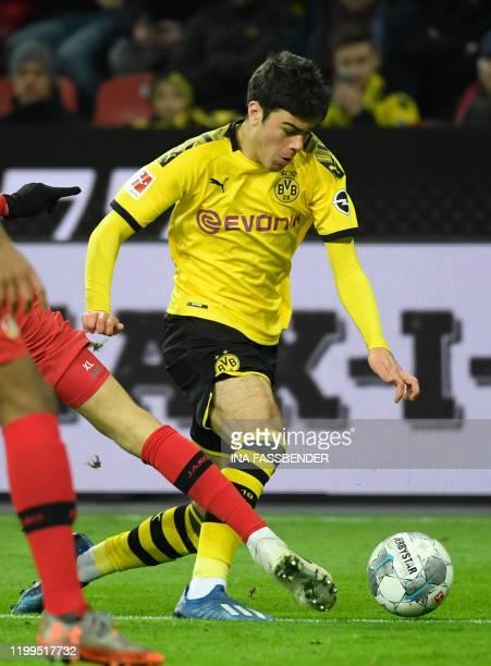 Dortmund's US midfielder Giovanni Reyna vies for the ball during the German first division Bundesliga football match Bayer 04 Leverkusen vs BVB...