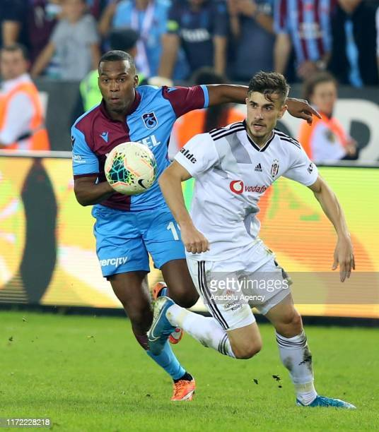 Dorukhan Tokoz of Besiktas in action against Sturridge of Trabzonspor during the Turkish Super Lig soccer match between Trabzonspor and Besiktas at...