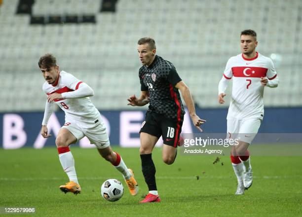 Dorukhan Tokoz of Turkey in action against Mislav Orsic of Croatia during a friendly match between Turkey and Croatia at Vodafone Park in Istanbul,...