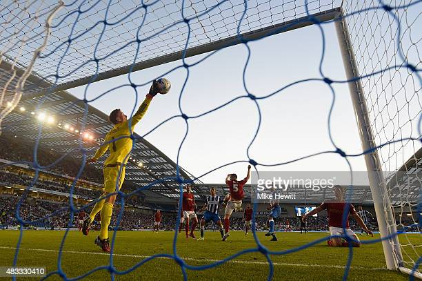 Dorus De Vries of Nottingham Forest makes a save from a header by Tomer Hemed of Brighton during the Sky Bet Championship match between Brighton Hove...