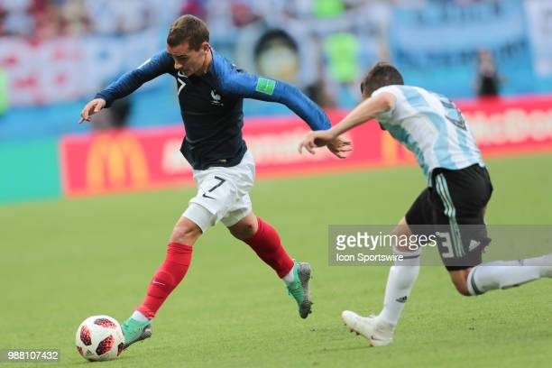 Dorward Antoine Griezmann of France National team and defender Nicolas Tagliafico of Argetina National team during the round of 16 match between...