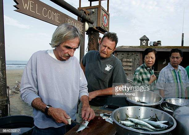 Dory fisherman Frank Leal prepares his catch of mackerel and sardines for market at the Newport Beach dory fleet Sixteen years after an oil tanker...