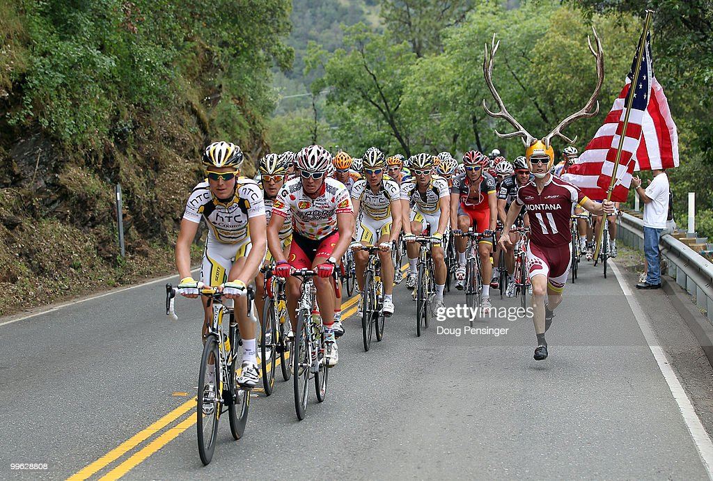 Dory Holte of Oregon chases the peloton with an American Flag as they climb the KOM during Stage One of the 2010 Tour of California from Nevada City to Sacramento on May 16, 2010 in Auburn, California.