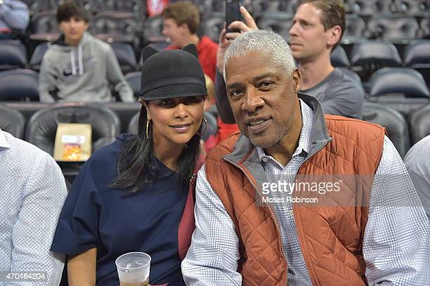 Dorys Madden and husband former NBA player Julius Erving attends the Brooklyn Nets vs Atlanta Hawks playoff game 1 at Philips Arena on April 19 2015...