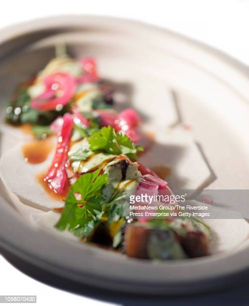 Dos Chinos' pork belly tacos is served at Cravings Food Village an Asiancentric food hall/warehousestyle supermarket in Chino Calif on Thursday Oct...