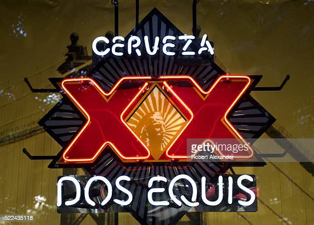 Dos Equis beer neon sign glows in a restaurant window on the Strip in Las Vegas Nevada