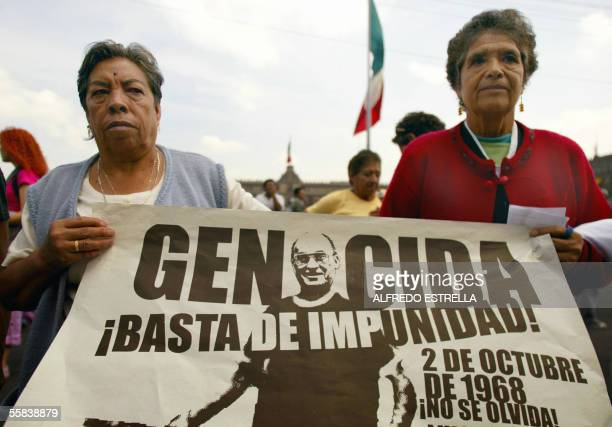 Dos mujeres muestran una pancarta con la cara del ex presidente de Mexico Luis Echeverria durante la manifiestacion por el 37 aniversario de la...