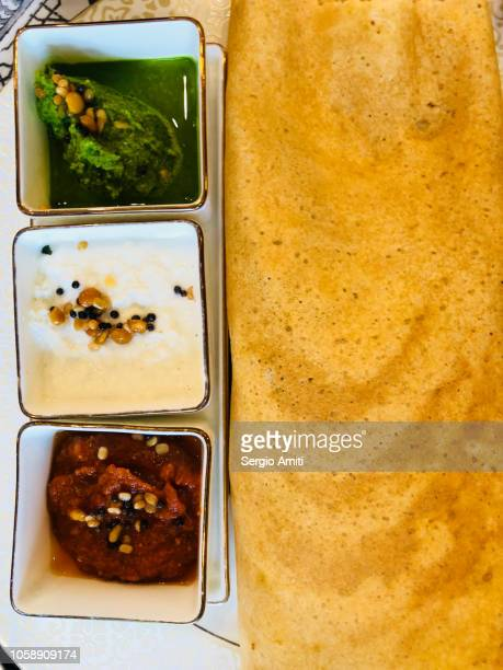 dosa with curry, dahal and coconut chutney - dosa stock photos and pictures