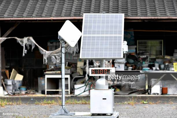 A dosimeter set up along a restricted section of National Route 114 shows a high radiation reading on September 20 2017 in Namie Fukushima Japan A...