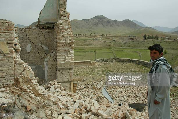 Dost Muhammad, a Northern Alliance soldier at the former Afghan Defense Ministry compound in Reshkhor , walks through the U.S. Bombed main...