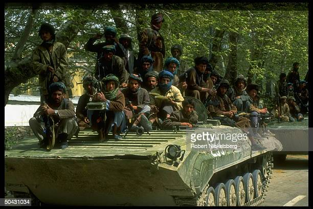 Dostamled Uzbek militiamen manning APC advancing on dissident mujahedin forces led by Hekmatyar in postNajibullah internecine battle for control of...