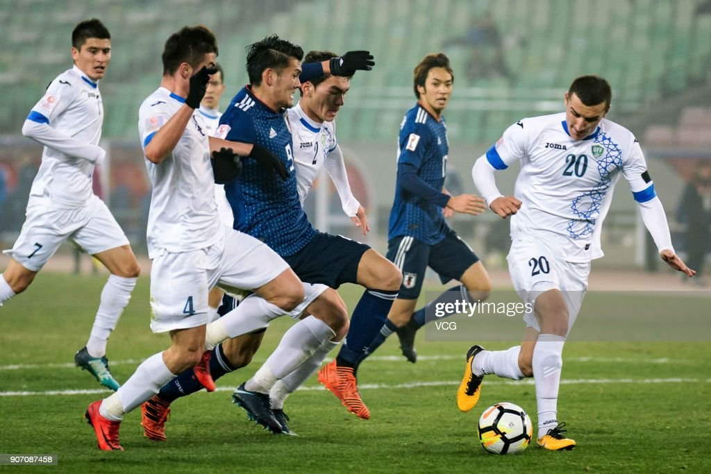 Dostonbek Tursunov #20 of Uzbekistan controls the ball during the AFC U-23 Championship quarter-final match between Japan and Uzbekistan at Jiangyin Stadium on January 19, 2018 in Jiangyin, Jiangsu Province of China.