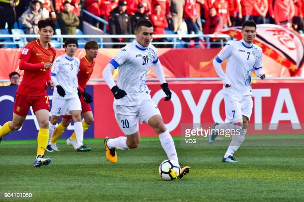 Dostonbek Tursunov of Uzbekistan drives the ball during the AFC U23 Championship Group A match between Uzbekistan and China at Changzhou Olympic...