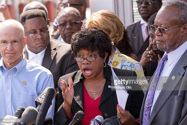 Dot Scott the President of the Charleston Chapter of the NAACP surrounded by members of the board holds a press conference to discuss the police...