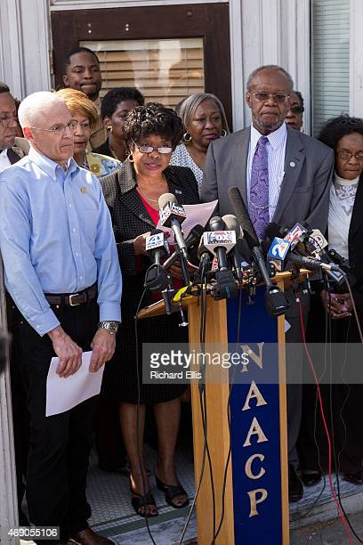Dot Scott the President of the Charleston Chapter of the NAACP surrounded with members of the board holds a press conference to discuss the police...