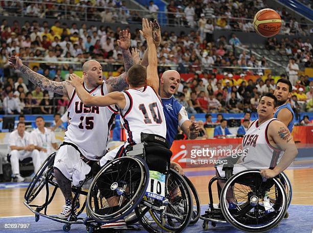 Dotan Meishar of Israel clashes with Jeff Glasbrenner and Joe Chambers of the US in their Group B basketball game at the 2008 Beijing Paralympic...