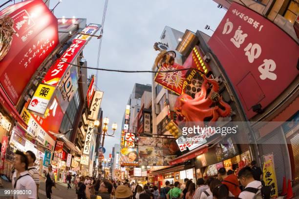 dotonbori in osaka, japan - takoyaki stock pictures, royalty-free photos & images