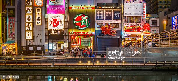 Dotonbori nightlife crowds at popular restaurants bars panorama Osaka Japan