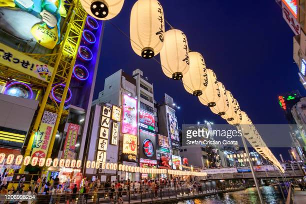 dotonbori river in osaka at night, japan - 大阪市 ストックフォトと画像
