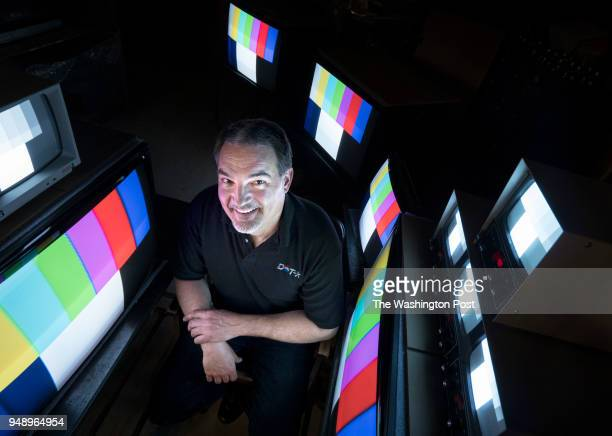 Dotronix owner Kurt Sadler sits amidst an array of monitors including the curved DNR27 at his warehouse in New Brighton Minn Thursday April 12 2018...