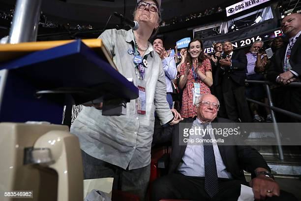 Dottie Deem along with the Vermont delegation and Sen Bernie Sanders cast their votes during roll call on the second day of the Democratic National...