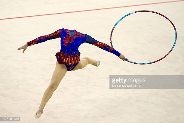 Dou Baobao of China performs during the rhythmic gymnastics individual allaround final during the 16th Asian Games on November 26 2010 Anna Alyabyeva...