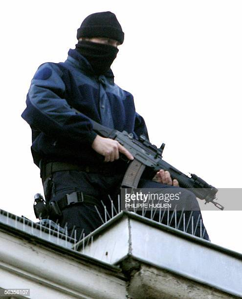A French elite police member watches the courthouse vicinity as Lionel Dumont a 34yearold convert to Islam who fought with Muslim insurgents in...