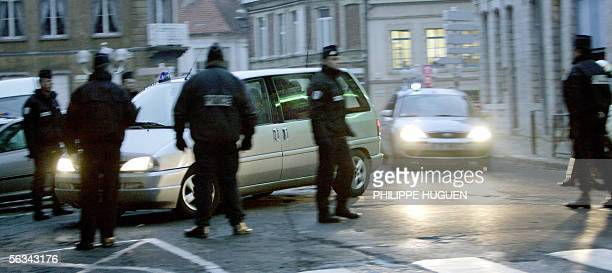 Lionel Dumont a 34yearold convert to Islam who fought with Muslim insurgents in Bosnia is escorded by elite police members as arriving by car at the...