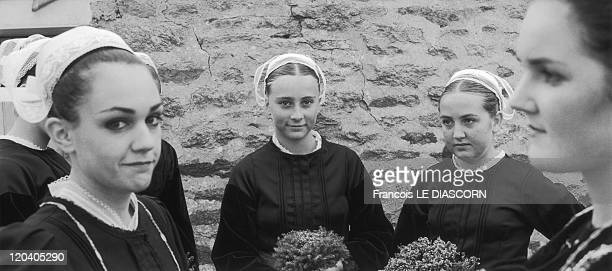 Douarnenez Brittany France Young Breton women wearing traditional lace caps worn in the town of Douarnenez Brittany during the Ajoncs festival in Cap...