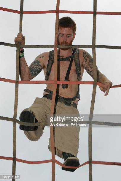 Double amputee soldier Lance Bombardier James Simpson tackles the cargo net climb during the Spartan Super Race at West Midlands Water Ski Centre...