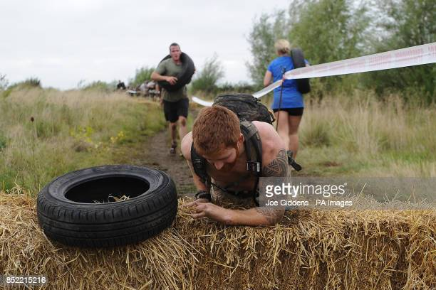 Double amputee soldier Lance Bombardier James Simpson tackles the Spartan Super Race at West Midlands Water Ski Centre Warwickshire PRESS ASSOCIATION...