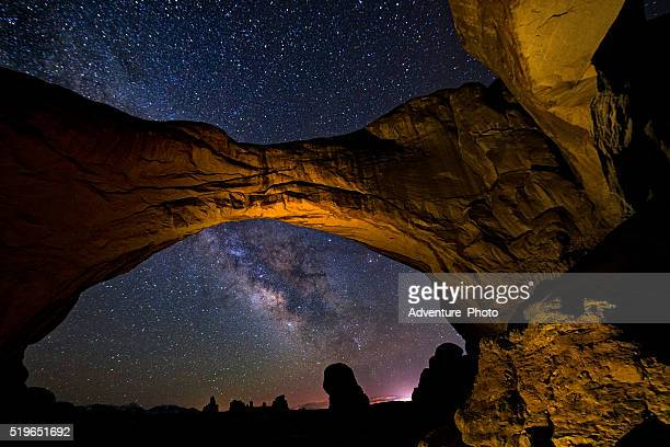 double arch milky way galaxy arches national park utah - moab utah stock photos and pictures