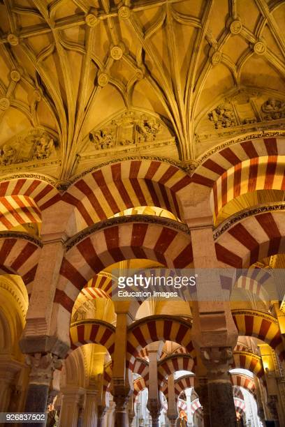 Double arches and ceiling with Old Testament figures at the Hypostyle Prayer Hall in the Cordoba Cathedral Mosque