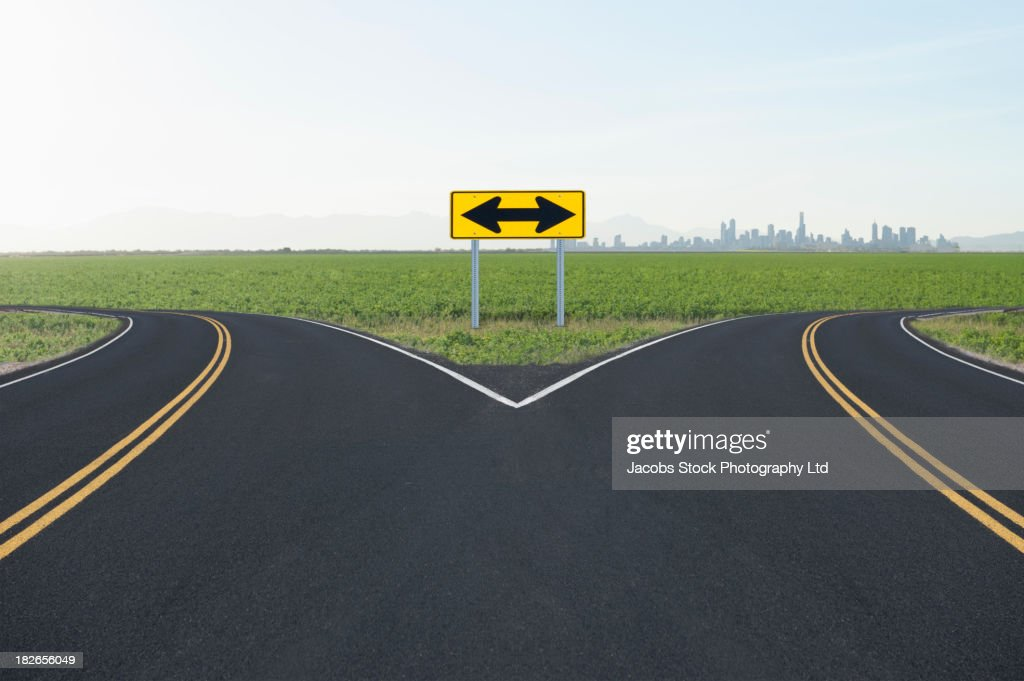 Double arrow road sign at fork, Denver, Colorado, United States : Stock Photo