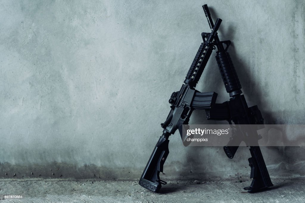 Double assault rifle on gray background, terrorist,robber concept. : Stock Photo
