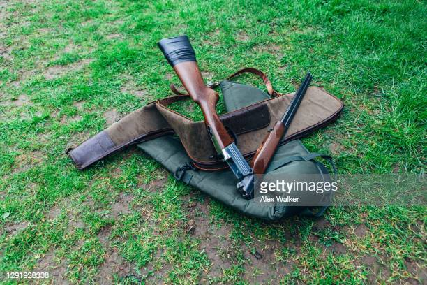 double barrel shotgun on carry case - shooting crime stock pictures, royalty-free photos & images