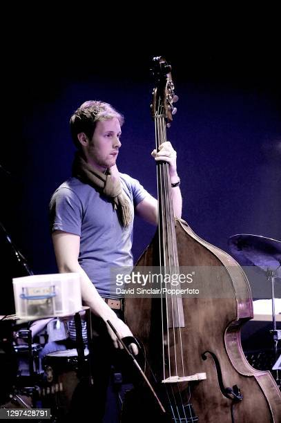 Double bass player Chris Hill performs live on stage at Ronnie Scott's Jazz Club in Soho, London on 27th January 2009.