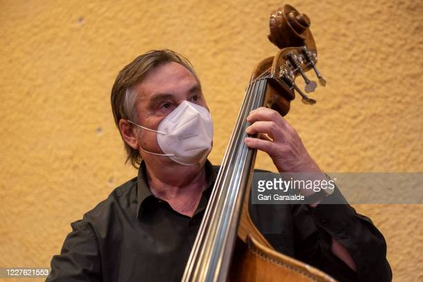 A double bass player from the Basque Symphony Orchestra plays his instrument before the concert that will be broadcast by public television on May 28...