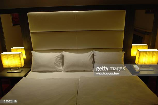 double bed ready for good night sleep - his and hers stock pictures, royalty-free photos & images