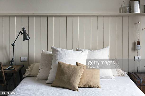 double bed with pillows and cushions - florence douillet photos et images de collection