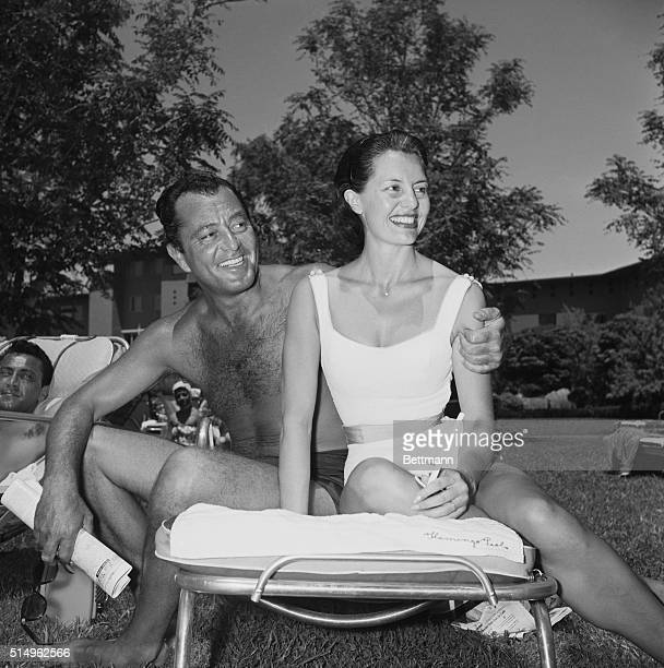 Double Billing--Between a busy schedule in Las Vegas, Nevada, Tony Martin and his wife Cyd Charisse, absorb some sun at the Flamingo where the singer...