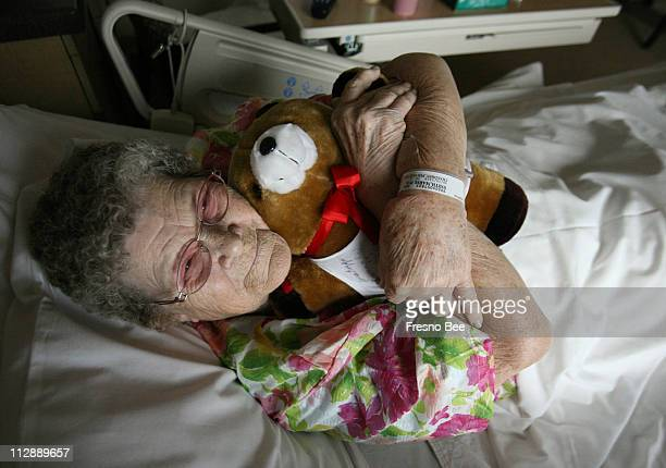 Double bypass recipient Marie Smith hugs a teddy bear as part of her recovery after having surgery several days ago at the Fresno Heart Hospital...