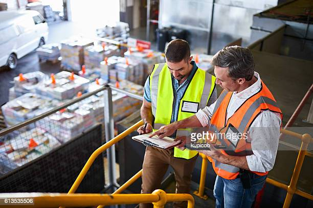 double checking their shipping schedule - heavy industry stock photos and pictures