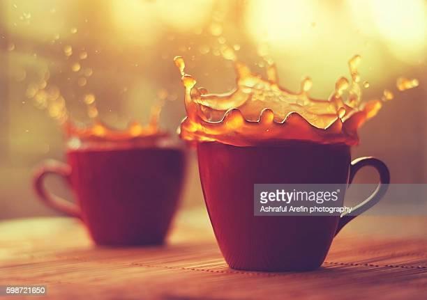 Double coffee splash and tea cups