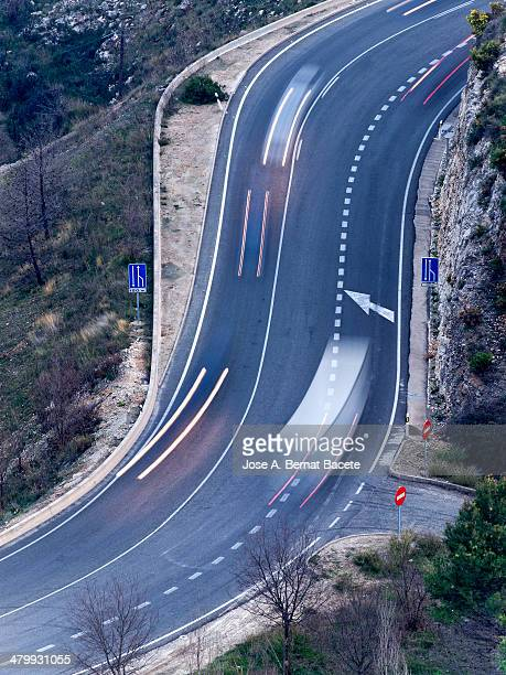 Double curls in a road with stelas of vehicles